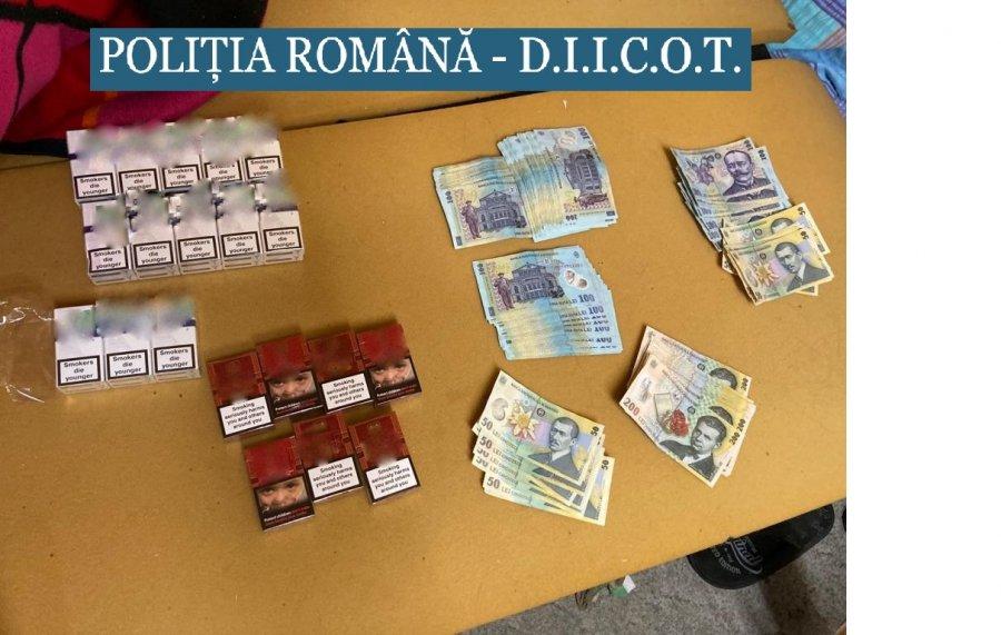 Trei persoane reţinute pentru constituirea de grup infracţional organizat şi contrabandă cu ţigarete